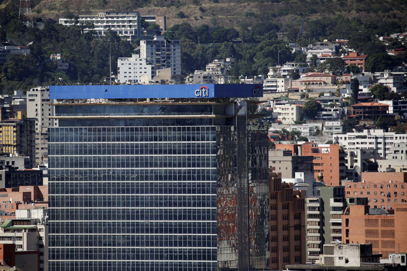 The logo of Citi is seen atop a building in Caracas, Venezuela February 8, 2017. Picture taken February 8, 2017. REUTERS/Marco Bello To match Exclusive VENEZUELA-BANKS/