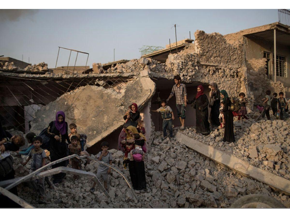 Separados por los guerra, los niños iraquíes esperan a sus padres