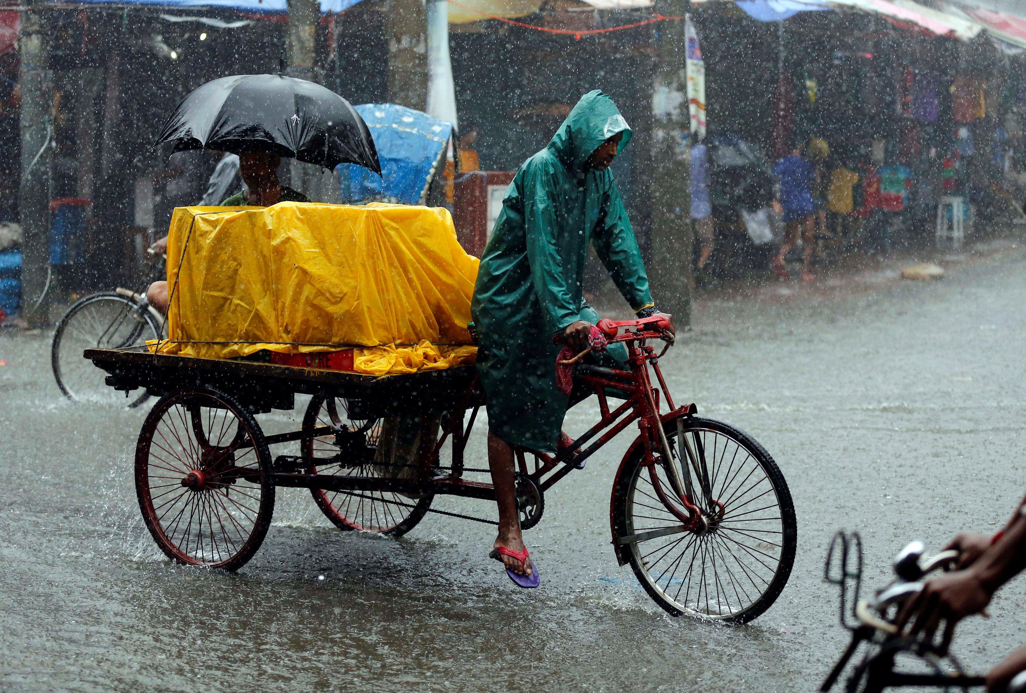 A person drives a van during heavy rain in Dhaka, Bangladesh July 26, 2017. REUTERS/Mohammad Ponir Hossain